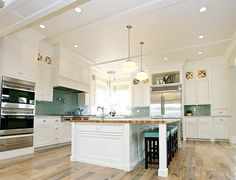 kitchen - ♥ the turquoise subway tile back splash, the bead board ceilings & the hardwood floors