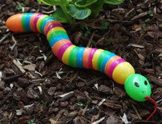 Plastic Egg Snake. Heiden is obsessed with snakes. Of course we made two of these today! Great use for all those plastic Easter eggs!