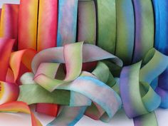Hanah Silk Ribbon is 100% Silk Ribbon. Yummy....I use this beautiful silk ribbon in my artwork. Gorgeous hand dyed silk ribbon colors make these a great embellishment for any project. The colors in this collection are: briar rose, rudbeckia, green apple, beach glass , echinacea, peace , lavender rosebud, monet, auralina and mother spirit . Ribbon can be used for dollmaking, scrapbooking, card making , invitations, and any other craft project that you may be working on. I like to always keep…