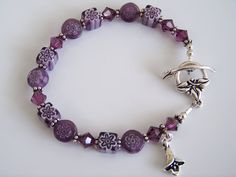 Purple Millefiori and Swarovski Crystal Beaded Bracelet - Item B0388. $22.00, via Etsy.