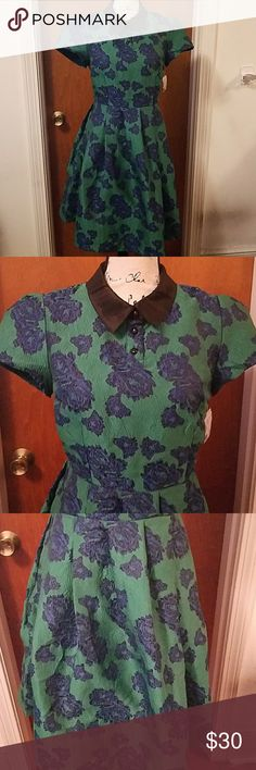 """Modcloth blue green floral peter pan collar dress Gorgeous blue and green floral with black peter pan collar dress with swing skirt. Three buttons at the neck and a zipper in the back. I've never worn this dress and it still has the tag with the extra button but I accidentally removed the other tag. 17"""" bust armpit to armpit, 34"""" length. Modcloth Dresses Midi"""