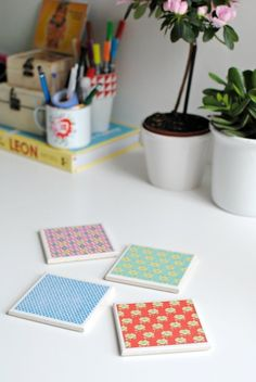 LOVE these as a YW activity or lazy Sunday craft!  Patterned Paper Coasters | Community Post: 17 Coaster DIYs Made With 20-Cent Tile