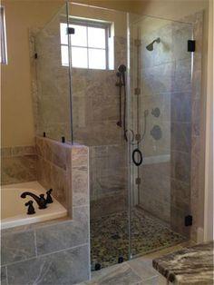 Custom tiled master shower with mosaic glass tile flooring.