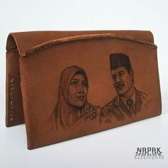 self potrait drawing on genuine leather wallet handcrafted, handsticking, hotpen Made in Bandung Indonesia whatsapp +6281322365446