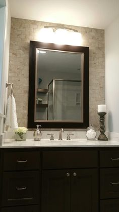 Subway tile vanity wall and white marble countertops. Sherwin williams turkish coffee cabinet paint.