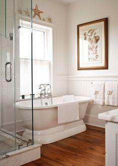 Wood floor, soaking tub...