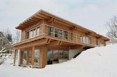 Simple roof line, love the wrap around deck and the way it's built into the hill