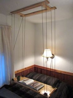 Hanging table.  Could use as maybe a dumbwaiter from the loft and/or a hanging table in the loft?