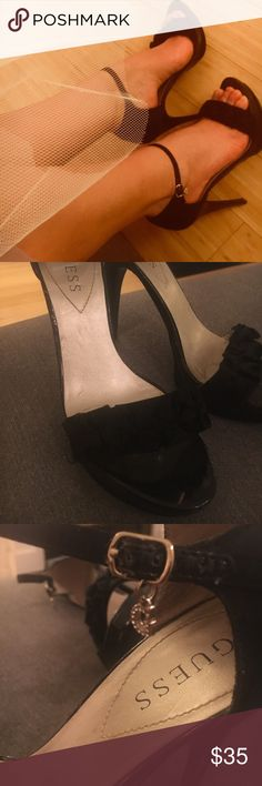 Guess strappy pumps Sleek satin strappy pumps by Guess, perfect for holiday party's and NYE! Ankle straps have charm detail and these are in excellent condition with minimal wear on the soles. Guess Shoes Heels