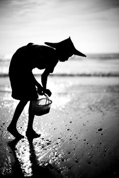 "© Marc Erwin Babej, ca. late 2000s, Bounty of the Beach, Burma (Myanmar) --- ""Bounty of the Beach"" is a really amazing picture. The shape of the woman is almost calligraphic. She is slim and bent over, wearing a hat. It's beyond symbolism. It stands for a way of life and an orientation to the world. It has a transcendent character."