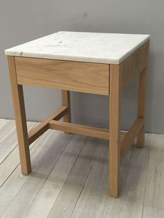carrara marble or oak top solid american oak base with a single drawer,natural white oil finish.all timber oak inner drawer.push on drawer opening system.available in walnut and different variations of marble tops.available in natural oil finish,s...