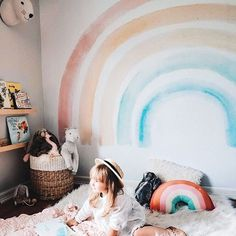 """""""At the end of the Rainbow, is my Rainbow baby."""" - 🌈 We are swooning over this picture of our new Elsi Mural!"""
