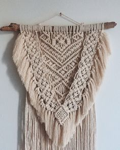 A personal favorite from my Etsy shop https://www.etsy.com/listing/522314487/macrame-wall-hanging-geometric-tapestry