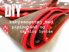 LaRaLiL: DIY babysengetøj med piping/tittekant. Husk at sætte nålene på langs med lynlåsen når den skal syes i!