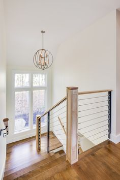 Nestled into an established Camden neighborhood, the spacious sunlit interior of this three-bedroom home is hidden behind its modest exterior. The div… - Decoration For Home Modern Stair Railing, Modern Stairs, Basement House, House Stairs, Interior Architecture, Interior Design, Happy House, Modern Wall Decor, Living Room Remodel