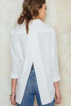 The white shirt with a twist! The Disarm Shirt is oversized with raw edges at th. The white shirt with a twist! The Disarm Shirt is oversized with raw edges at the collar and overlapping split back. Fashion Mode, Fashion Outfits, Womens Fashion, Fashion Trends, White Shirts Women, Dress Shirts For Women, Classic White Shirt, Look Retro, Mode Inspiration