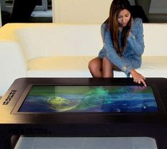 Planning to buy a new coffee table for your living room? It's time you should bring home a stylish multi touch table.Interactive Multi touch tables are a quite popular in Australia and in other parts of the world. Table Interactive, Interactive Design, Film Science Fiction, Smart Table, Pc Table, Coffee Table Design, Coffee Tables, Cool Technology, Teaching Technology