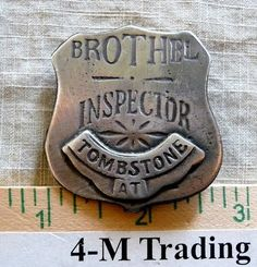 TOMBSTONE BROTHEL INSPECTOR BADGE  (BADGES OF THE  OLD WEST)