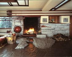 In Fallingwater in Pennsylvania, of 1937, Frank Lloyd Wright created an organic inglenook from boulders on site. He had almost ritualistic attitude toward the hearth as the very center and soul of a home.