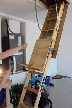 DIY attic storage assistance use a pulley system to help loadupthe attic ladder - Home Projects We Love Attic Organization, Attic Storage, Storage Organizers, Ladder Storage, Bedroom Storage, Eaves Storage, Bike Storage, Attic Ladder, Attic Stairs