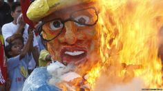 Philippine President Benigno Aquino's effigy is burned in protest against his labour policy. Demonstrators say he favours foreign investors at the expense of local workers' rights.