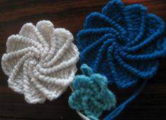 Free pattern to make these Crocheted swirl flowers
