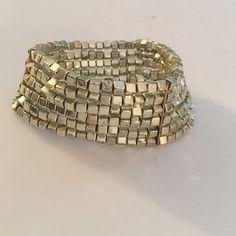 Golden stretch bracelet Golden squares make up this 6 layer stretchy bracelet. Jewelry Bracelets