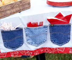 Custom Country Table Runner ~ Dress up a picnic table with a one-of-a-kind runner. Add some country flair to a plain white table runner by cutting 2-inch-wide strips of red Western-style fabric and then sewing them along the border. Cut out back pockets from old pairs of blue jeans. Attach pockets to the table runner with a hot-glue gun to create pouches that can hold straws, plastic tableware, and napkins. So cute, great for a farm or cowboy/girl themed party or 4th of July party