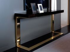 Contemporary console tables are essential to design pieces in any modern interior. This modern furniture is often found in entryways and hallway, the support fo Modern Console Tables, Decor, Interior Design, Instyle Decor, Living Room Decor Modern, Interior, Modern Table, Home Decor, Furniture Design