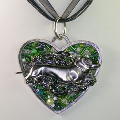 Delightful Large Mosaic DACHSHUND Pendant Necklace--one of kind, Dachshund lover ,Wire Wrapped Pendant, Beaded jewelry, handmade jewelry, Gift for dog lover.   I created this piece especially for Dachchund lovers (Like I am!). The metal pendant is shaped like a heart and has a background of little green glass beads. The Dachchund is on a pretty filigree finding and is attached to the pendant. It comes on a 17 black organza ribbon necklace with a 2 chain extension. The jump ring is large…