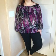 Purple patterned blouse Pretty purple colored blouse. It has long sleeves. The neckline is really stretchy and can be worn off the shoulder. Semi sheer. Flowy and lightweight. 100% polyester. I'm modeling as 18/20, 40f/g, 5'7. Pure Energy Tops Blouses