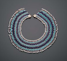 Blue and White Beaded Collar | Museum of Fine Arts, Boston - Blue and White Beaded Collar  Mfengu peoples 20th century DIMENSIONS Height x diameter: 5.7 x 21.6 cm (2 1/4 x 8 1/2 in.)  Glass beads, buttons and string