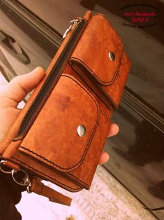 Large wallet made of genuine leather.