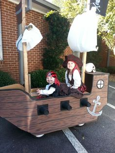 Pirate ship made with cardboard and using kids wagon.