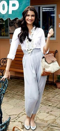 Sonam Kapoor carrying Ferragamo. Bollywood celebrity bag style.