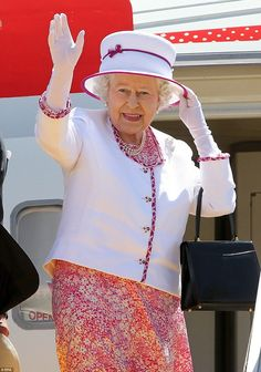 Looks familiar: The Queen wearing the same Karl Ludwig dress as she steps off a Royal Flight plane at Perth Airport