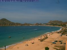 Live view of Cabo San Lucas #Mexico overlooking beautiful Médano Beach. This is the view from the Villa del Arco Beach Resort in Cabo. Beautiful!