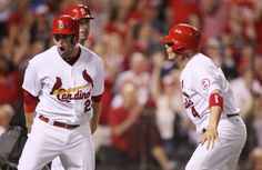 t. Louis Cardinals David Freese reacts after he and teammate Yadier Molina (right) both scored on a single by pinch hitter Daniel Descalso in the eighth inning during a game between the St. Louis Cardinals and the Kansas City Royals on Wednesday, May 29, 2013, at Busch Stadium in St. Louis. At right is Kansas City Royals pitcher Aaron Crow. Photo by Chris Lee, clee@post-dispatch.com