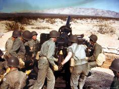 A soldier operates an anti-aircraft gun.