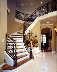 I want an extra-wide grand staircase with scrolled iron balusters, polished wood rails that match polished wood treads, and slate tile risers. Dream Home Design, My Dream Home, House Design, Grand Entryway, Entry Foyer, Railing Design, Staircase Design, Iron Staircase, Luxury Homes