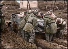"'Rasputitsa' - stuck in the deep mud, German soldiers struggle to move a Type 82 Kubelwagen of the SS Division ""Leibstandarte Adolf Hitler"" in the Vinnytsia region of the Ukraine. November 1943 'Rasputitsa' - (Russian: распу́тица; IPA:..."