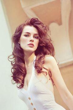 Red auburn long curly hair pale skin