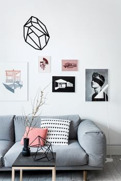 grey couch white walls