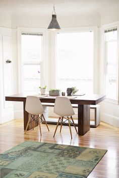 wood table, white chairs, bay window + bench! - Carly & Scott's Colorful Collected Apartment