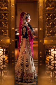 traditional indian bride wearing bridal lehenga and jewellery