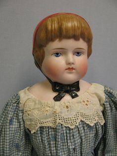 """19"""" Early Molded Hat German Bisque Doll c1880 RED CAP & BLACK RIBBONS from turnofthecenturyantiques on Ruby Lane"""