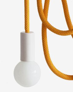Pani Jurek Loop Line The less the better. One source of light in the whole house! Long scrolls of rope let the light move all over the apartment. Decorative loops you can hang under the ceiling or as a scone lamp on the wall. You can also go with the light to another room.