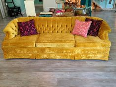 The absolute perfect mustard velvet tufted sofa...  <3