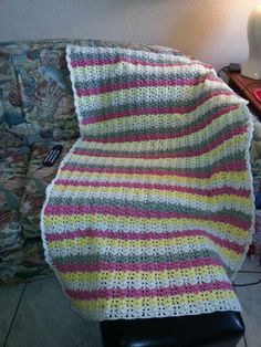 Lap blanket pink yellow green and cream colors very thick and warm.