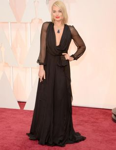 Margot Robbie. Beautiful black gown. This gown was beautiful in person. Love the soft chiffon long sleeves. She looks amazing.